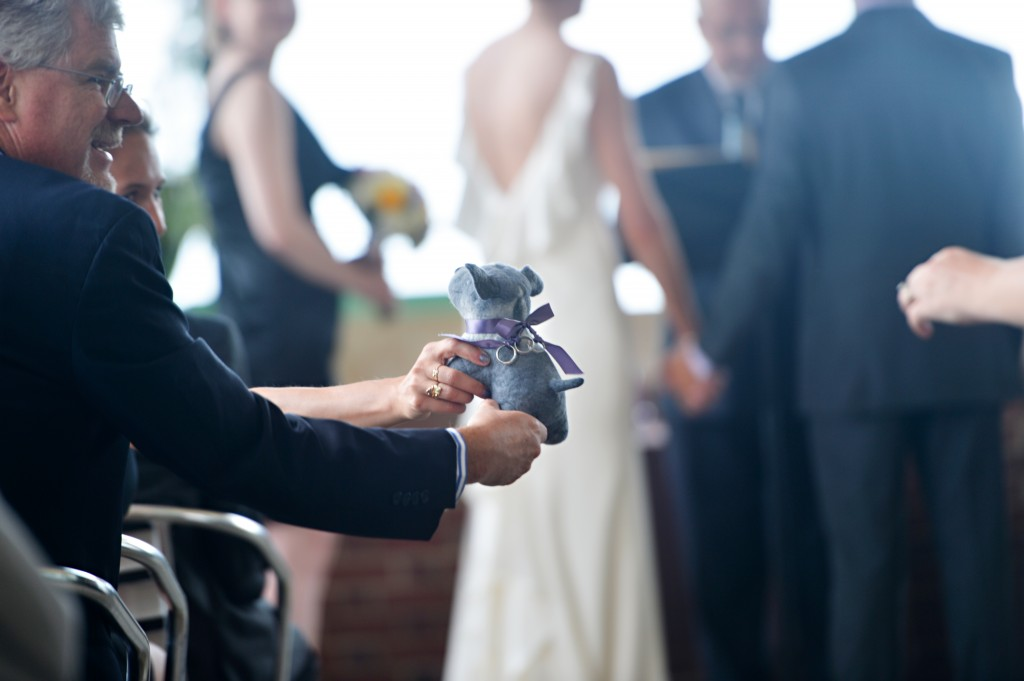 Johanna and Matt put lots of personal touches into their ceremony including tying their wedding bands to a stuffed dog and passing the dog around to all their guests during the ceremony so that each guest could touch the rings and send them love and support through their touch.