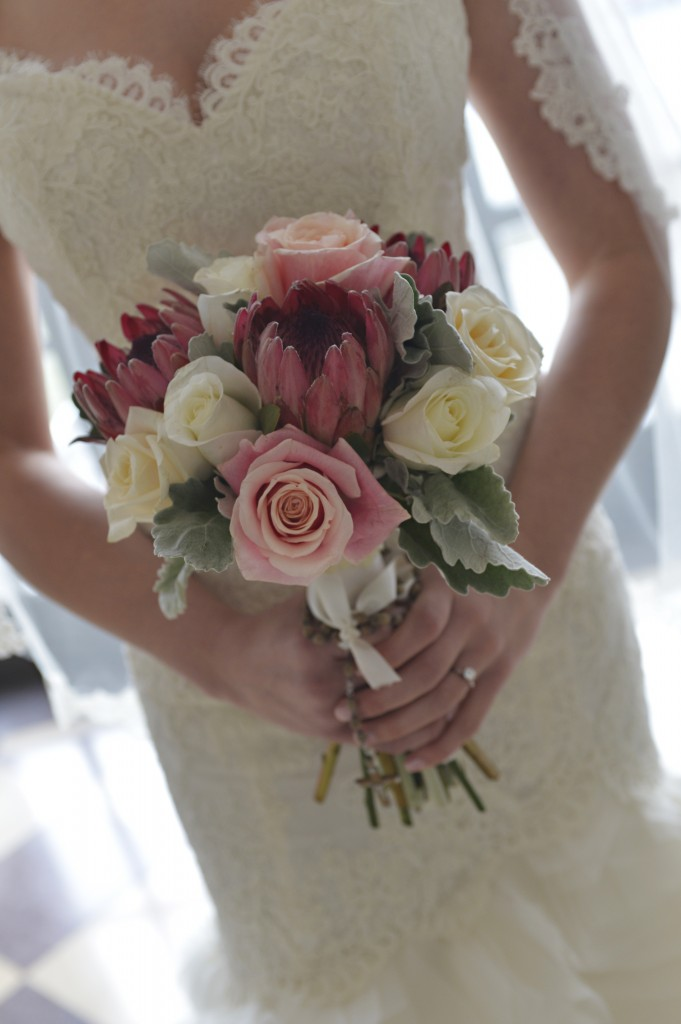 Alison's bouquet featured protea and her grandfather's rosary from the Vatican.