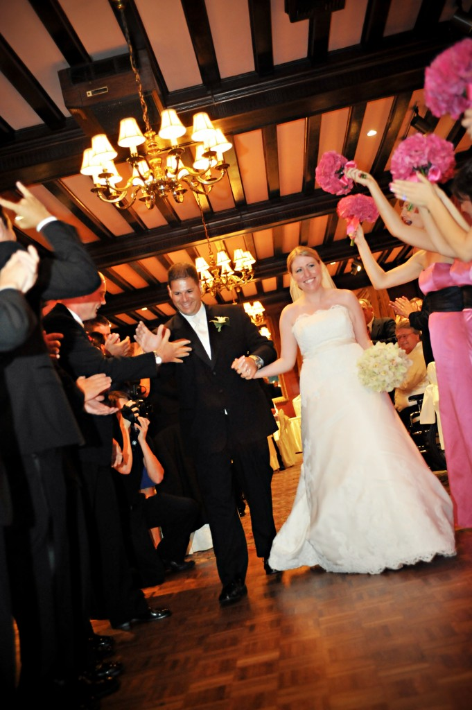 Courtney and Mike are all smiles as they make their entrance into the reception as husband and wife