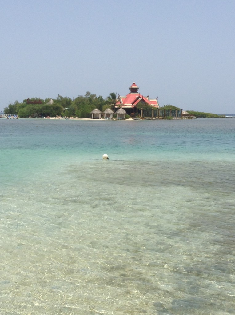 View of Sandals Cay from the dock at Sandals Royal Caribbean resort. Cabanas are shown to the left of the Royal Thai restaurant. The clothing optional beach is on the left side of the island.