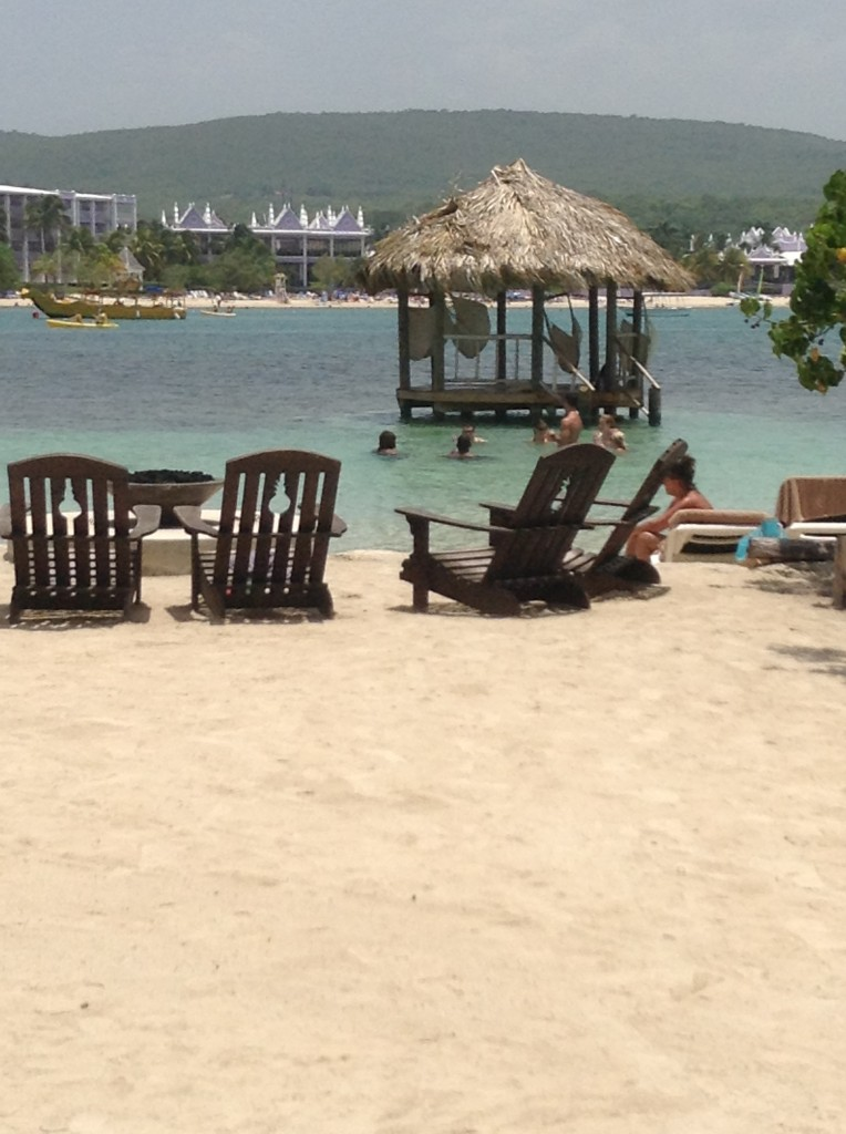 View from Sandals Cay back to Sandals Royal Caribbean Resort. Firepit on the beach. Gazebo in the water with hammocks. If I close my eyes I can see us there.....