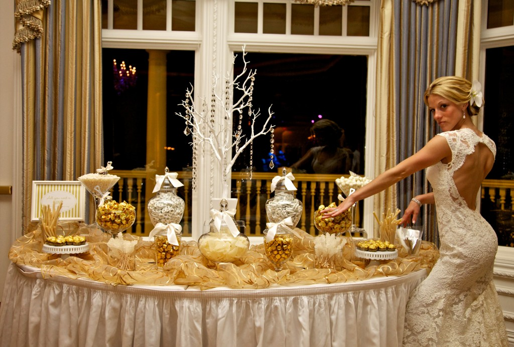 Portia and Greg's wedding at Eagle Oaks CC featured an gold and white candy buffet by Lisa's Candy Buffet.