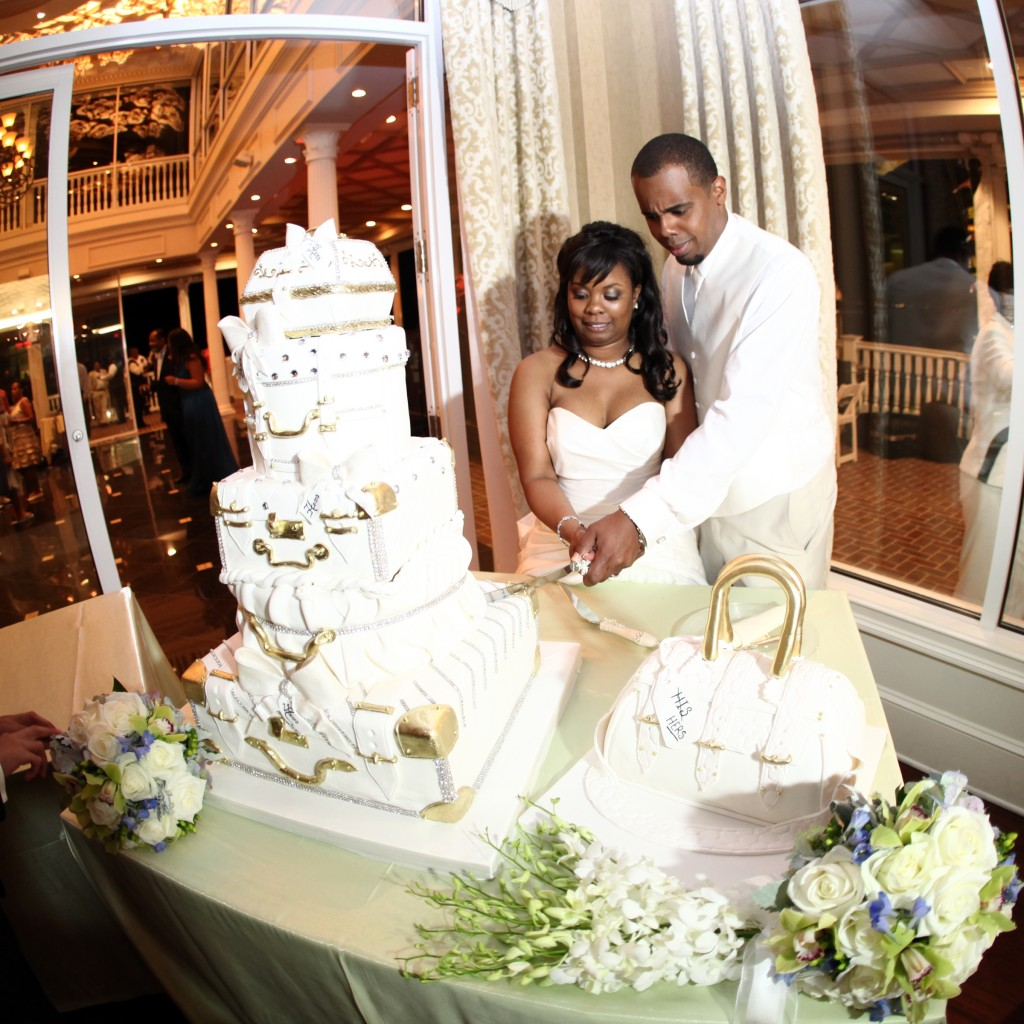 "Khadijah and Kandar's wedding theme was ""journey to Love"" Cake shaped and decorated like suitcases formed the beautiful wedding cake. A bride's cake was a purse. Photo courtesy of Ann Coen Photography"