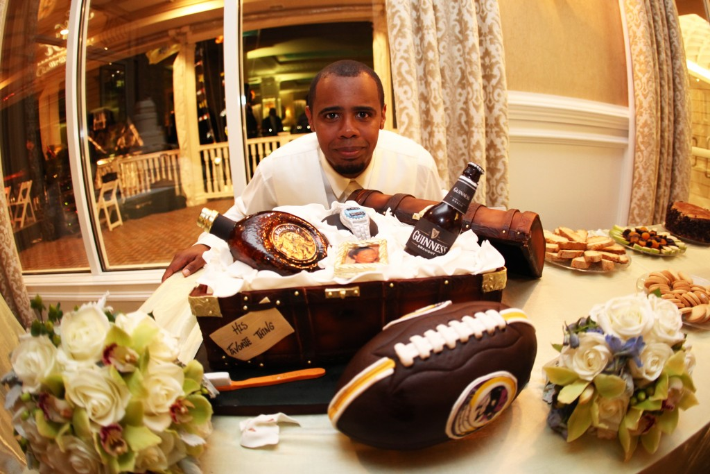 Kandar's groom's cake featured everything he loves from football to alcohol in its own custom case. Photo courtesy of Ann Coen Photography