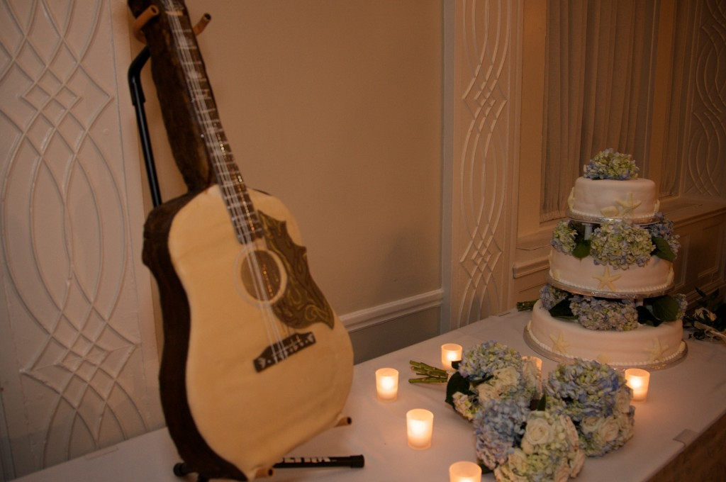 Alix surprised John with a groom's cake made by a family friend that's a replica of his favorite guitar . Photo courtesy of Jason Meehan Photography