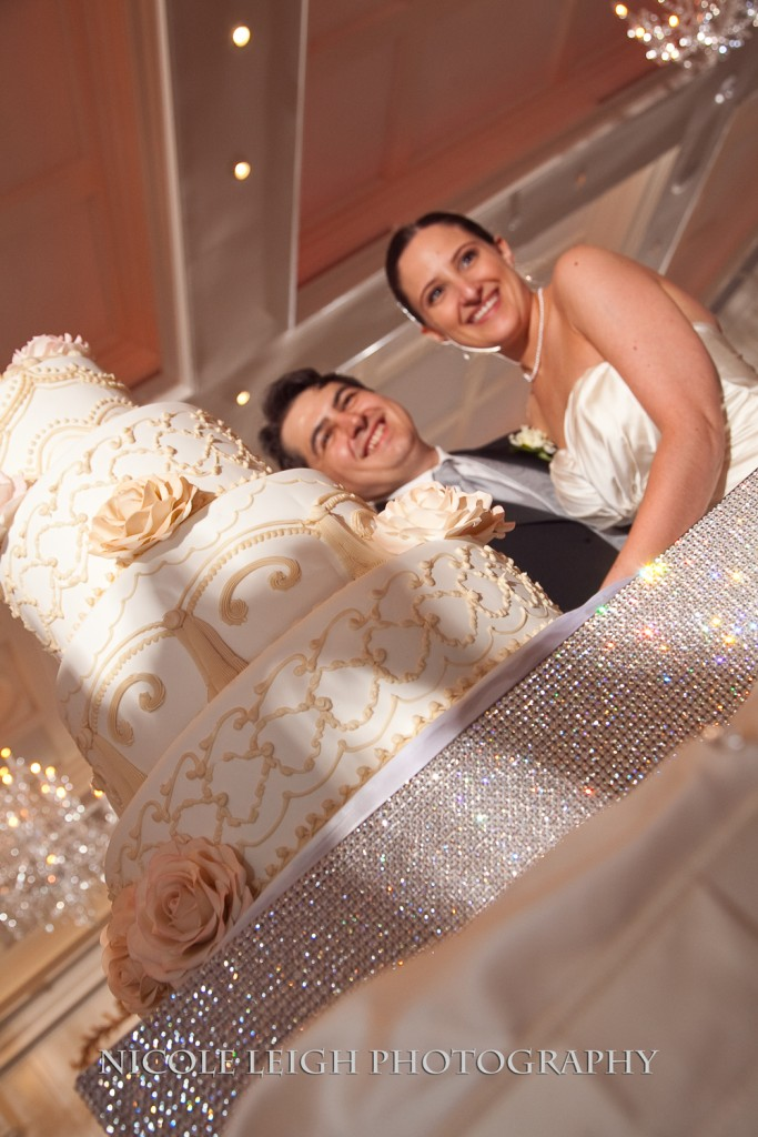 "Elaina and TJ had an ""in"" at Carlos Bakery for their wedding cake. Photo courtesy of Nicole Leigh Photography"