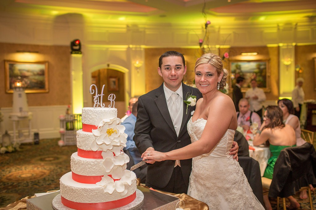 LOVE the petaled sugar flower camellias on Jessica and Rich's cake. Photo courtesy of Endless Wave Studios.