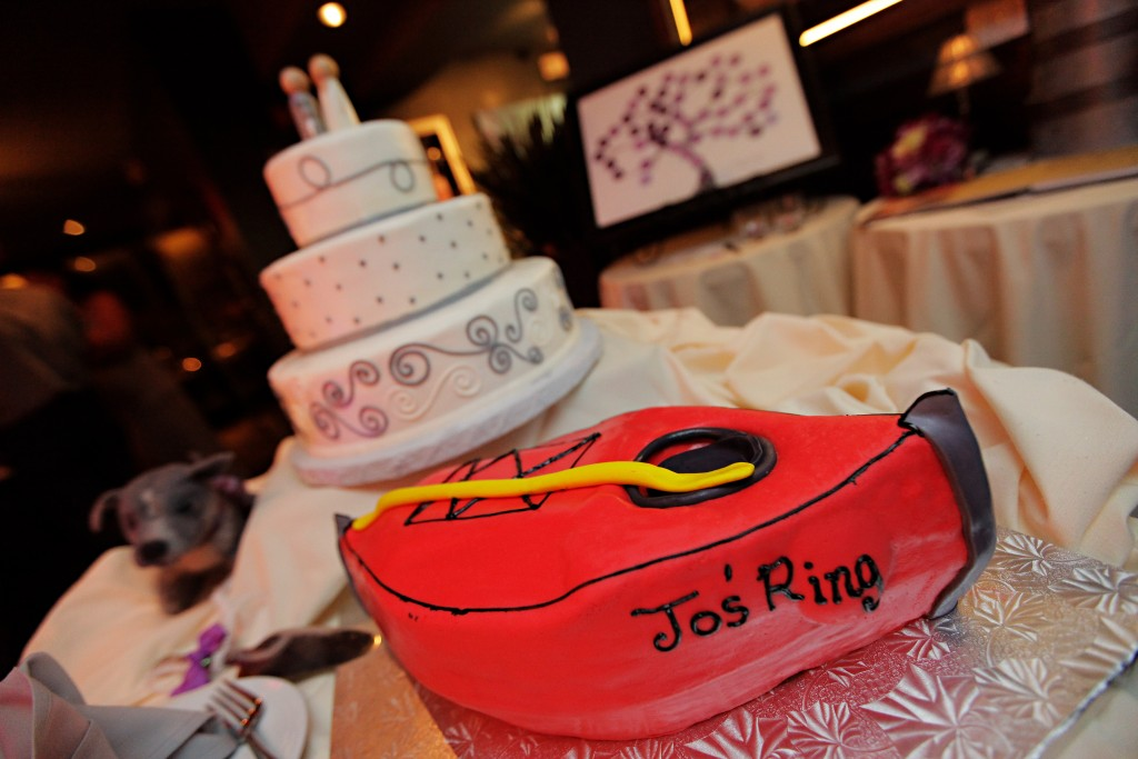 Johanna surprised Matt with a custom groom's cake. Matt gave up his kayak to buy Johanna her engagement ring. Photo courtesy of John Arcara Photography.