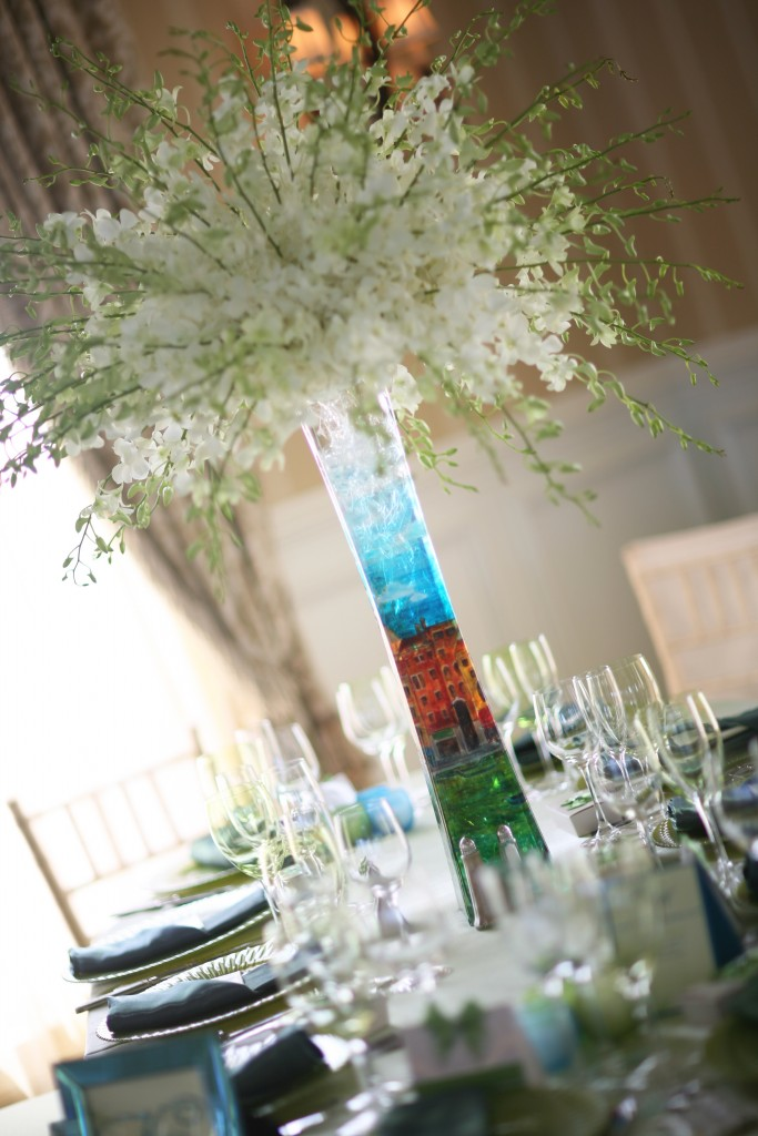 Explosions of tiny white dendrobium orchids fill hand painted vases at Khadijah and Khandar's reception. Photo courtesy of Ann Coen Photography