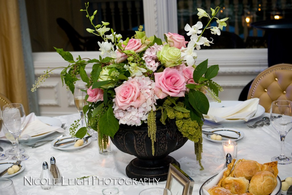 Alicia and David's centerpieces featured pastel flowers mixed with greenery in urns