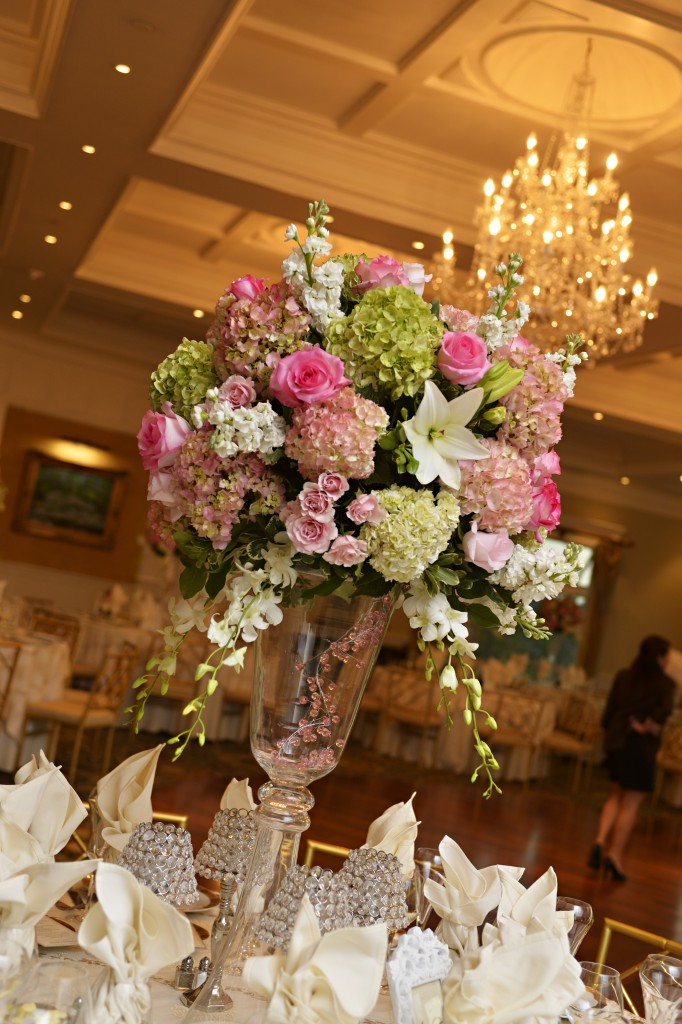 Tall, lush spring flowers atop a glass vase were the highlight of Andrea and Walter's reception. Photo courtesy of John Arcara Photography