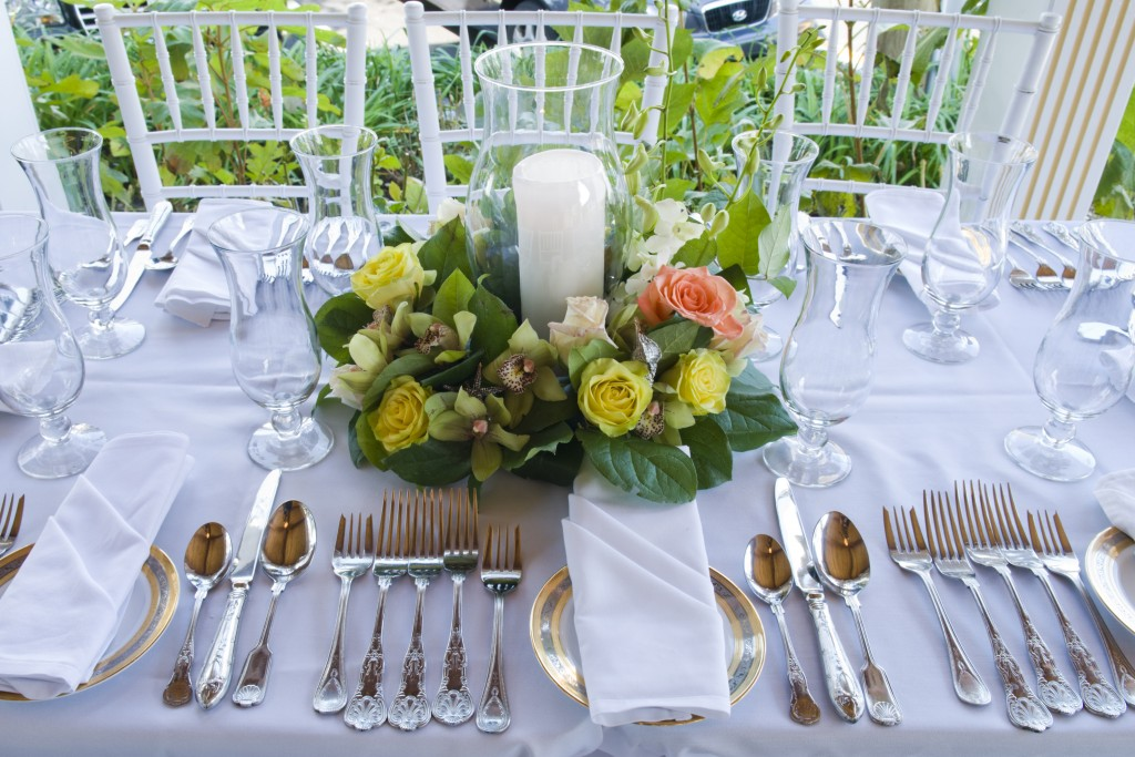 Elizabeth & Roger's wedding dinner was spread out over 3 rooms at a local restaurant. Roger's daughter was able to supply the flowers to a local florist who created lush arrangements for each table different for each room.
