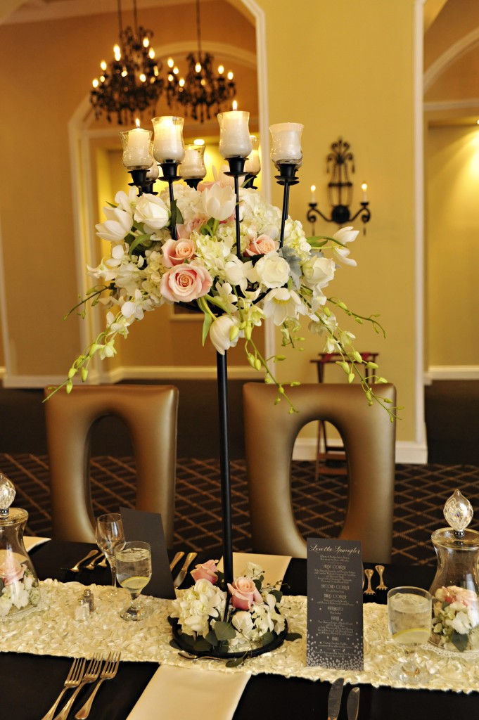Alison and Austen's New Year's Eve dinner featured the same candelabras that Caryn and Dan used. This time the arrangements were flowy and featured all pastel colors with more flowers at the base. Photo courtesy of John Arcara Photography.