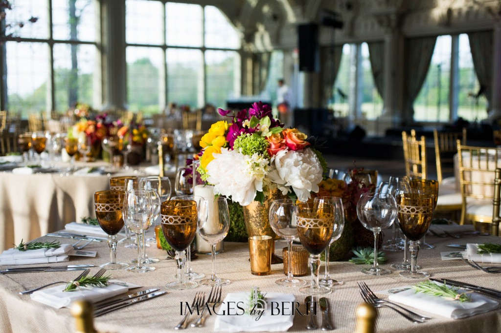 The centerpiece displays at Brian and Mike's wedding were unique at each table. Rustic, elegant, and lush with plenty of texture and color. Photo courtesy of Images by Berit.